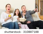 parents and daughter watching... | Shutterstock . vector #310887188