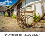 Cart With Milk Cans At Old...
