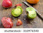 various colorful tomatoes with... | Shutterstock . vector #310976540