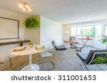 modern dining room in luxury...   Shutterstock . vector #311001653