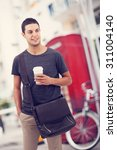 man walking and drinking coffee ... | Shutterstock . vector #311004140