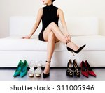 beautiful legs. woman trying... | Shutterstock . vector #311005946