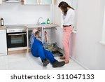 young repairman repairing sink... | Shutterstock . vector #311047133