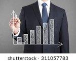 businessman drawing a growing... | Shutterstock . vector #311057783