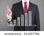 businessman drawing a growing... | Shutterstock . vector #311057786