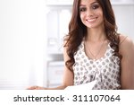attractive young businesswoman... | Shutterstock . vector #311107064