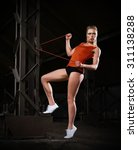 young sporty woman in orange... | Shutterstock . vector #311138288