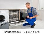 young handyman looking at... | Shutterstock . vector #311145476