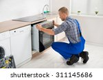 young repairman in overall... | Shutterstock . vector #311145686