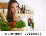 young woman holding grocery... | Shutterstock . vector #311150918
