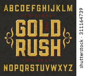 gold rush whiskey label font... | Shutterstock .eps vector #311164739
