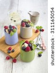 Small photo of Fruit salad with fresh berries and mint in a la carte dishes