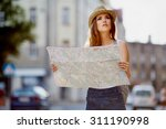 Female Tourist With Map...