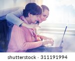 younger woman helping an... | Shutterstock . vector #311191994