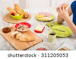 a young adult woman eating an... | Shutterstock . vector #311205053