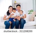 portrait of asian family | Shutterstock . vector #311208200