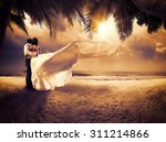 Wedding Couple With The Sunset...