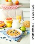 healthy breakfast with fruits... | Shutterstock . vector #311218628