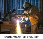 worker cutting metal with... | Shutterstock . vector #311232689