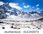 Mountain landscape in Sagarmatha National Park in the Nepal Himalaya - Mount Nuptse and Ama Dablam view. - stock photo