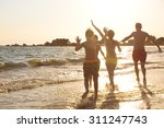 young family on the beach | Shutterstock . vector #311247743