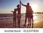 young family on the beach | Shutterstock . vector #311247830