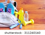sports bag with equipment on... | Shutterstock . vector #311260160
