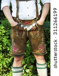 man in traditional bavarian... | Shutterstock . vector #311266199
