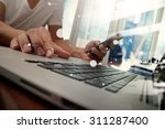 business man hand working on... | Shutterstock . vector #311287400