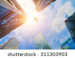 airplane flying over business... | Shutterstock . vector #311303903
