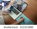 top view of businessman hand... | Shutterstock . vector #311311880