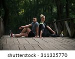 young couple stretching before... | Shutterstock . vector #311325770
