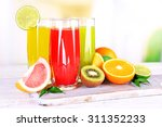 glasses of different juice with ... | Shutterstock . vector #311352233