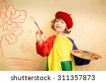 Small photo of Happy child playing at home. Drawing autumn theme. Imagination and freedom concept