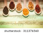 colorful spices on old wooden... | Shutterstock . vector #311376560