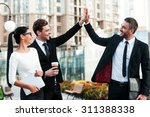 celebrating success. two happy... | Shutterstock . vector #311388338