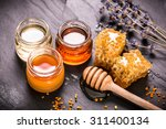 honey in jar with honey dipper... | Shutterstock . vector #311400134