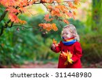 Little Girl With Yellow Leaf....