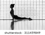 young woman practicing in a... | Shutterstock . vector #311459849