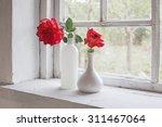Red Roses On Windowsill
