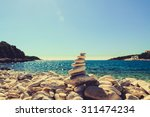 stones balance at the vintage... | Shutterstock . vector #311474234