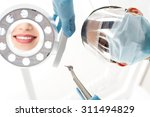surgical masked female dentist... | Shutterstock . vector #311494829