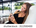 portrait of a happy elegant... | Shutterstock . vector #311500400