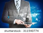 businessman holding tablet with ... | Shutterstock . vector #311540774