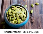 Pumpkin Seeds In Blue Bowl Ove...