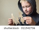 confused child with paper... | Shutterstock . vector #311542736