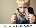 confused child with cutting... | Shutterstock . vector #311542820