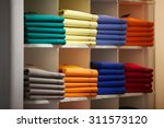 colorful sweater in shopping... | Shutterstock . vector #311573120
