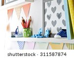 shelves with toys in child room ... | Shutterstock . vector #311587874