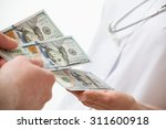 Patient's Hand Giving A Money...